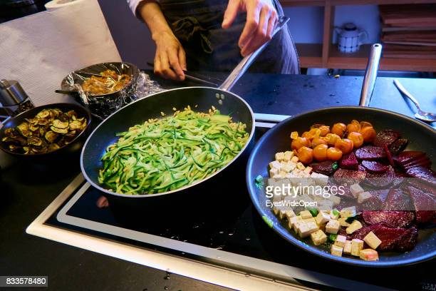 Vegetarian food with beet roots and vegetables is being prepared on April 21 2015 in Lana Italy