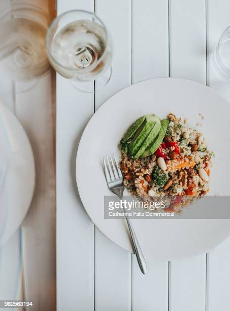 vegetarian meal, stylishly presented - vegan food stock photos and pictures