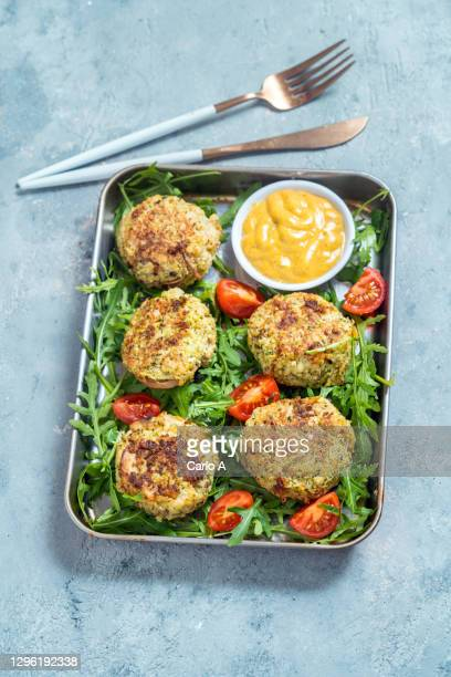 vegetarian patties in a baking tray - veggie burgers stock pictures, royalty-free photos & images