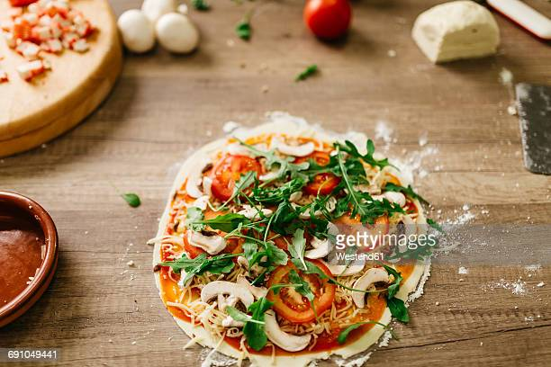 Vegetarian pizza prepared to be put in the oven