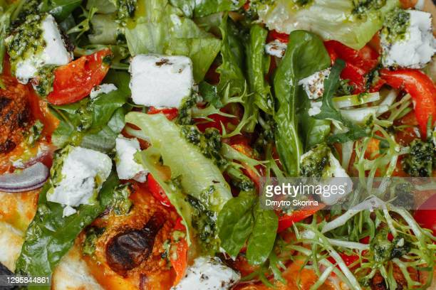 vegetarian pizza with cheese tomatoes greens
