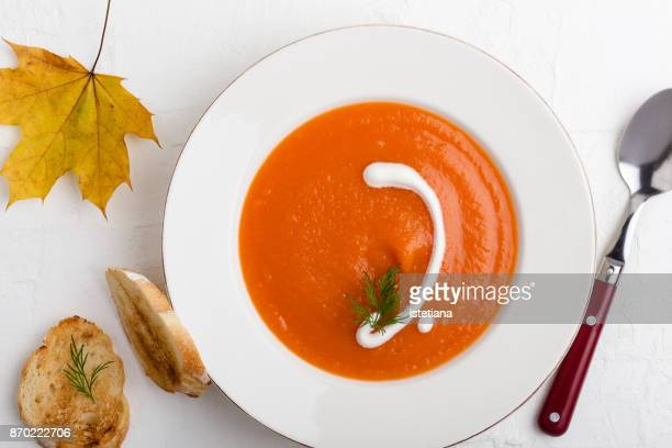 vegetarian pumpkin carrot soup - pureed stock pictures, royalty-free photos & images