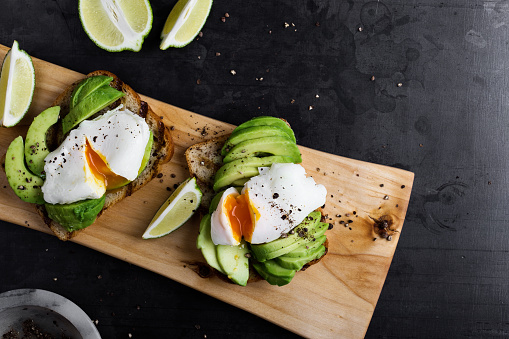 Vegetarian sandwiches with poached egg and sliced avocado - gettyimageskorea
