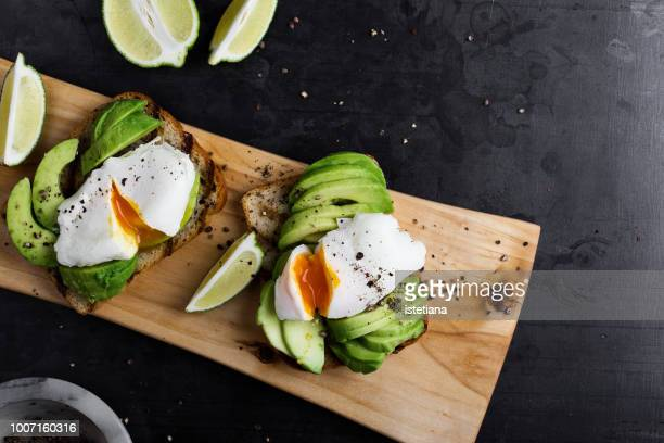 vegetarian sandwiches with poached egg and sliced avocado - boiled stock pictures, royalty-free photos & images