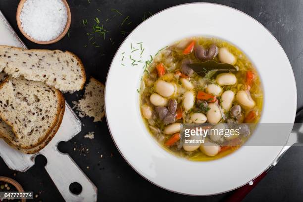 vegetarian soup with white beans and mushrooms - comfort food stock pictures, royalty-free photos & images