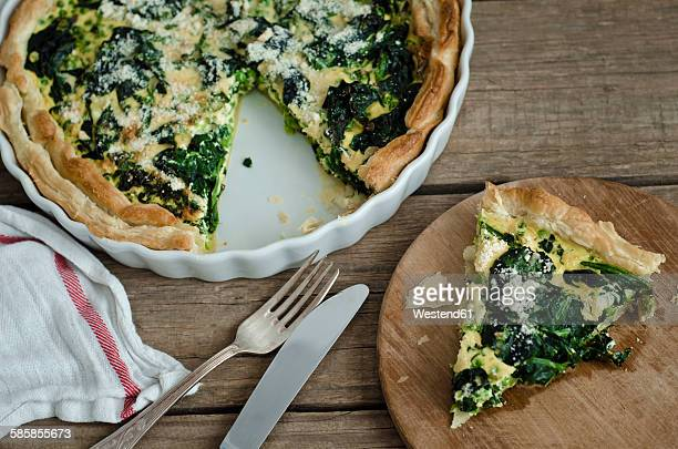 vegetarian spinach pea quiche - savory pie stock photos and pictures