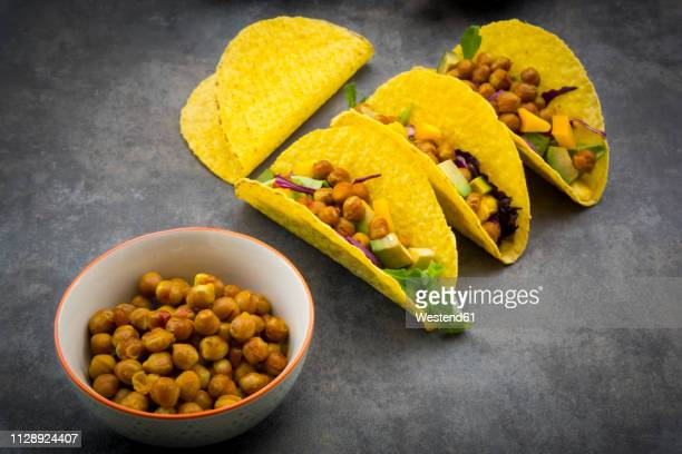 Vegetarian tacos with curcuma, roasted chickpeas, paprika, avocado, salad and red cabbage