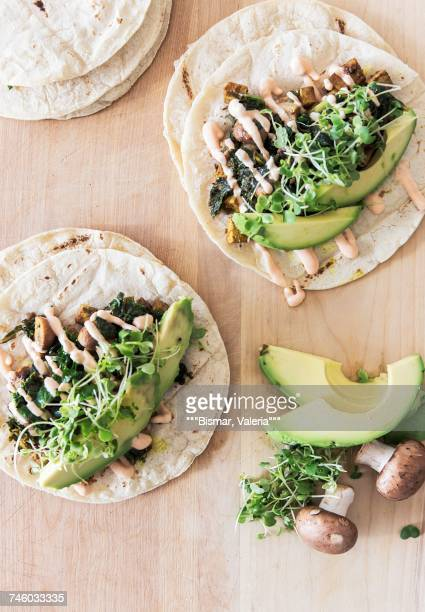 vegetarian tacos with vegan mayonnaise on a kitchen table with avocado, mushrooms and beans sprouts - mayonnaise stock pictures, royalty-free photos & images