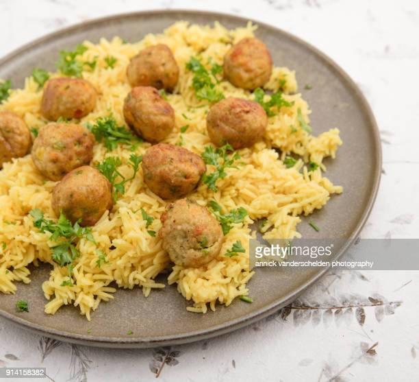Vegetarian vegetable balls on yellow rice.