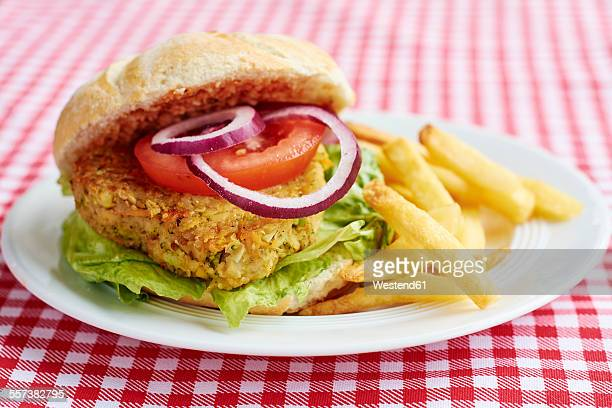 Veggi burger, broccoli, carrots, chickpeas, onions, served with French fries and ketchup