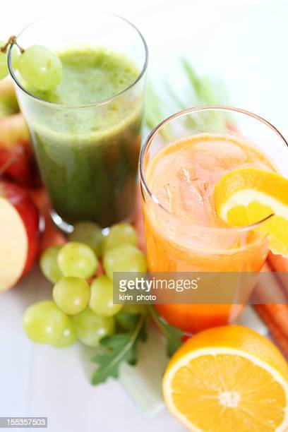 Veggie and fruit juices isolated on white table