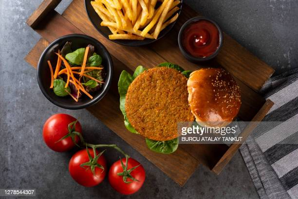 veggie burger with fries - veggie burgers stock pictures, royalty-free photos & images