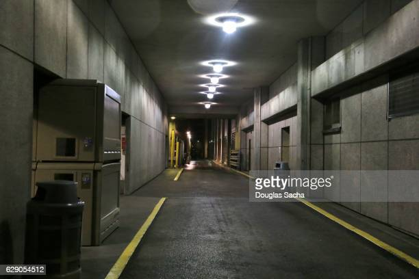 vehicle access tunnel in underground parking garage - bunker stock pictures, royalty-free photos & images