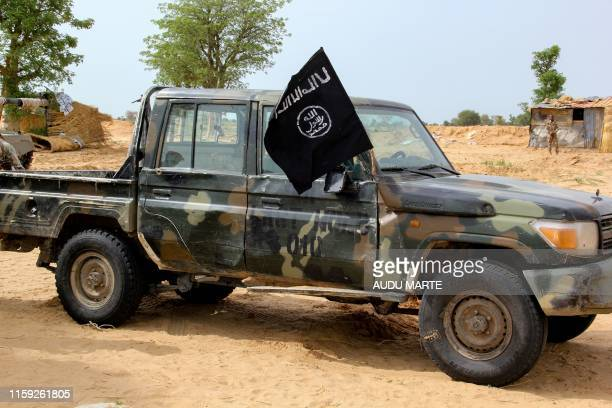 Vehicle allegedly belonging to the Islamic State group in West Africa is seen in Baga on August 2, 2019. - Intense fighting between a regional force...