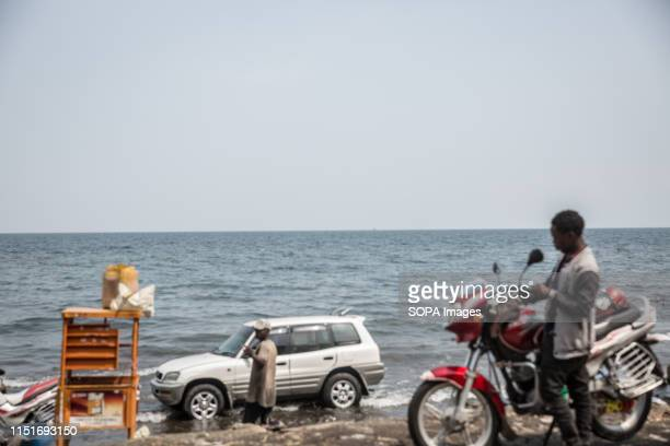 A vehicle and a motorcycle at the shores of Lake Kivu in Goma DR Congo is currently experiencing the second worst Ebola outbreak in recorded history...