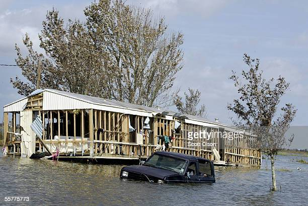 A vehicle and a trailer home sit covered by flood waters left in the wake of Hurricane Rita September 26 2005 near Henry Louisiana Rita hit land as a...