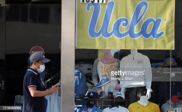 Vehicle and foot traffic were down substantially in Westwood Village as the coronavirus pandemic forced the closure of UCLA and many neighboring...