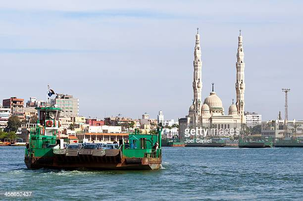 suez canal ferry and mosque - port said stock pictures, royalty-free photos & images