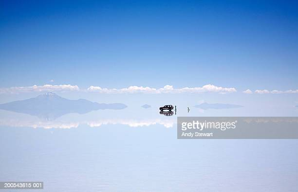 vehicle and people on salt flat - bolivia stockfoto's en -beelden