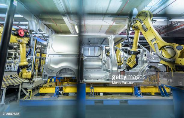 Vehicle and robots on production line in car factory