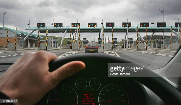A vehicle approach the M6 motorway toll booths on March 13 2005 in Birmingham England The number of vehicles using the Toll road which opened in...