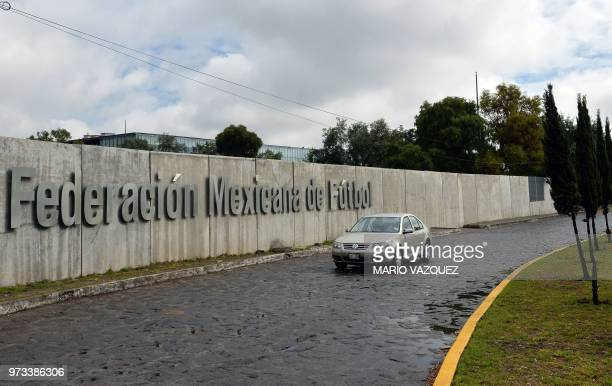 A vehicle arrives at the headquarters of the Mexican Football Federation in Toluca Mexico on June 13 2018 day in which FIFA announced the United...