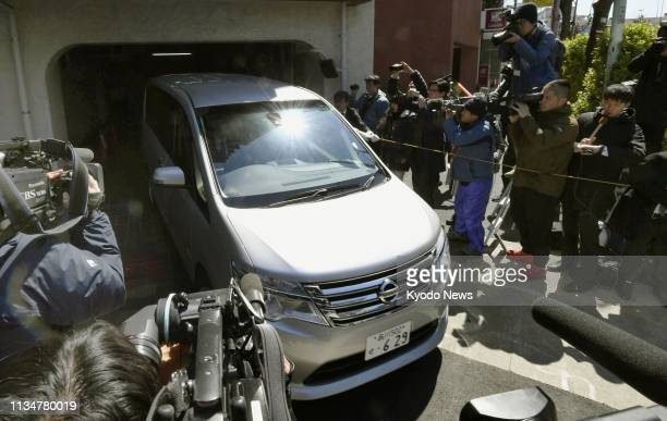 A vehicle believed to be carrying former Nissan Motor Co Chairman Carlos Ghosn leaves a condominium building in Tokyo on April 4 after prosecutors...