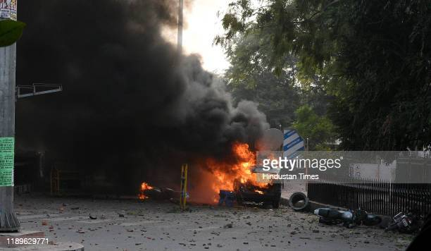 A vehicle burnes during an anti Citizenship Amendment Act and National Register of Citizens protest at Parivartan Chowk area on December 19 2019 in...