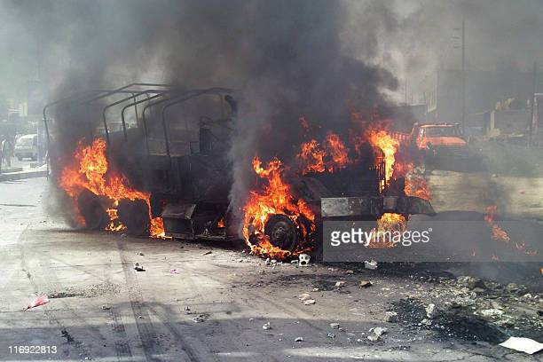 A vehicle burns during clashes between antigovernment protesters and security forces in Ibb on May 13 190 kms southwest of Sanaa where the elite...