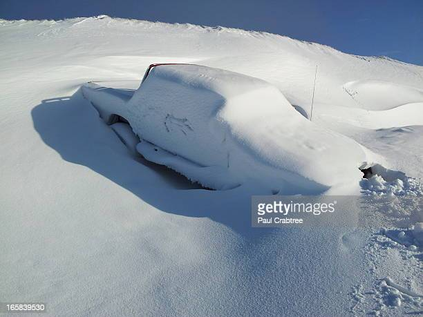 Vehicle came off the road and was later covered in drifting snow