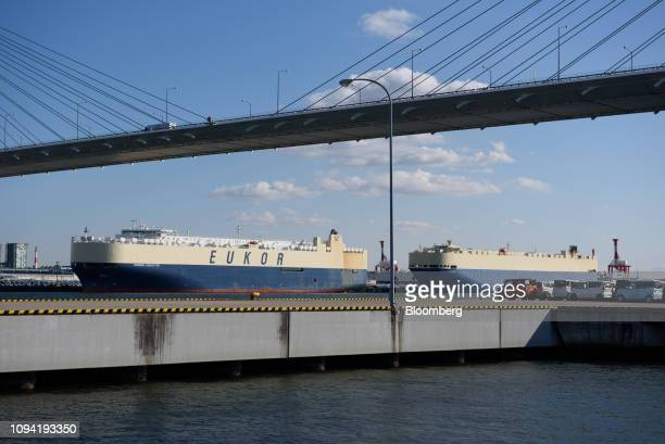 Vehicle carrier ships including the Eukor Car Carriers Inc Morning Conductor left sit berthed at the Nagoya Port in Tokai Aichi Prefecture Japan on...