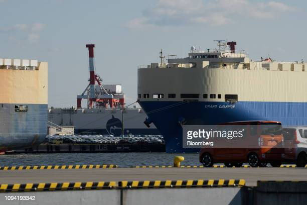 Vehicle carrier ships including the Kawasaki Kisen Kaisha Ltd Grand Champion right sit berthed at the Nagoya Port in Tokai Aichi Prefecture Japan on...