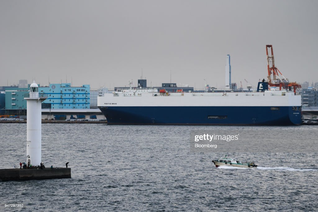 A vehicle carrier vessel is berthed at a shipping terminal in Yokohama, Japan, on Monday, April 16, 2018. Japan and China held their first high-level economic dialogue in almost eight years on April 16 against a backdrop of trade threats from the U.S. Photographer: Akio Kon/Bloomberg via Getty Images