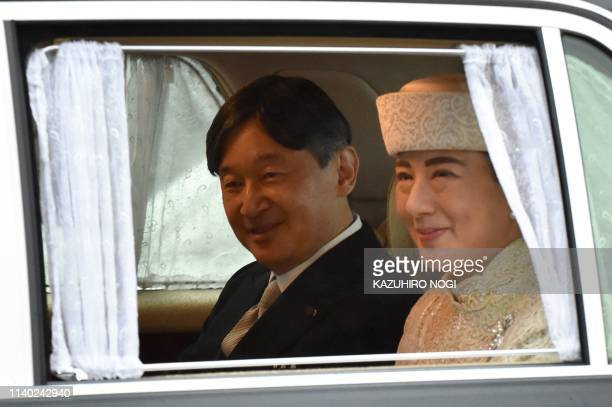 TOPSHOT A vehicle carrying Crown Prince Naruhito and Crown Princess Masako leaves the Imperial Palace in Tokyo on April 30 2019 Emperor Akihito of...