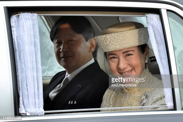 TOPSHOT A vehicle carrying Japan's Crown Prince Naruhito and Crown Princess Masako arrives at the Imperial Palace in Tokyo on April 30 2019 Emperor...