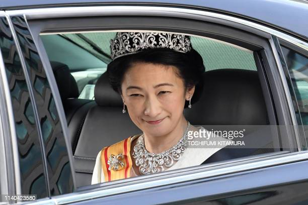 A vehicle carrying Japans Crown Princess Kiko arrives at the Imperial Palace in Tokyo on May 1 2019 Japan's new emperor Naruhito will formally take...