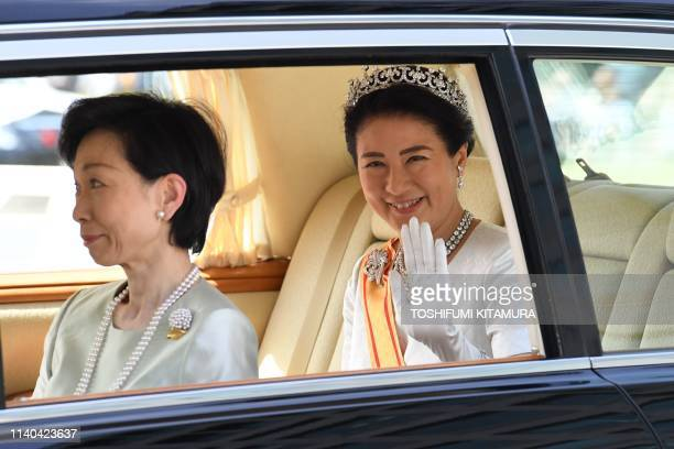 A vehicle carrying Japans Empress Masako arrives at the Imperial Palace in Tokyo on May 1 2019 Japan's new Emperor Naruhito formally ascended the...