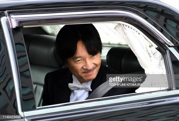 A vehicle carrying Japans new Crown Prince Akishino arrives at the Imperial Palace in Tokyo on May 1 2019 Japan's new emperor Naruhito will formally...