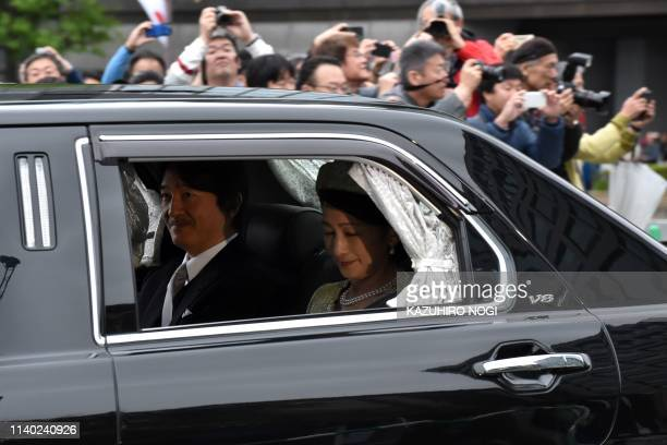 TOPSHOT A vehicle carrying Japan's Prince Akishino and his wife Princess Kiko arrives at the Imperial Palace in Tokyo on April 30 2019 Emperor...