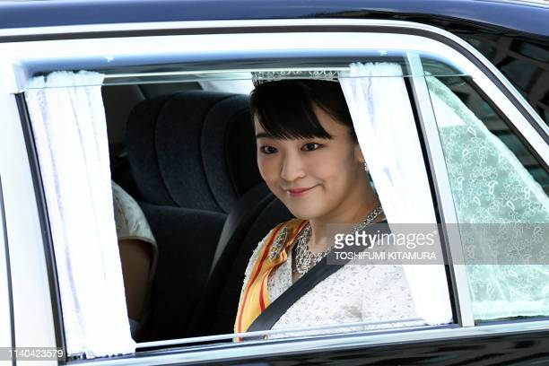 A vehicle carrying Japans Princess Mako daughter of Crown Prince Akishino arrives at the Imperial Palace in Tokyo on May 1 2019 Japan's new emperor...