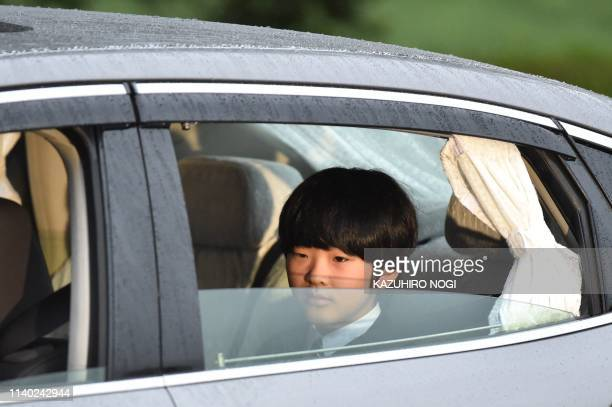 TOPSHOT A vehicle carrying Prince Hisahito son of Prince Akishino and Princess Kiko leaves the Imperial Palace in Tokyo on April 30 2019 Emperor...