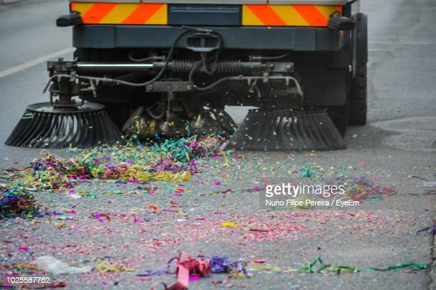 vehicle cleaning confetti on road - city cleaning stock pictures, royalty-free photos & images
