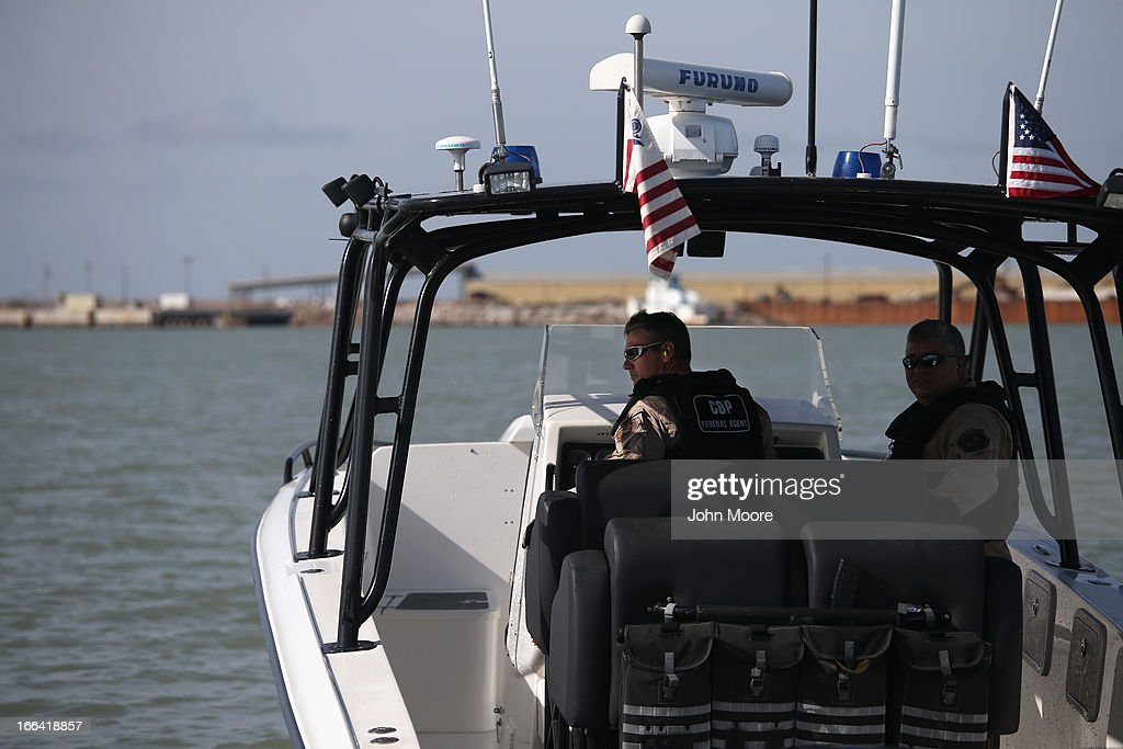 Vehicle commander P.J. Welch from the U.S. Office of Air and Marine (OAM) pilots a Midnight Express interceptor into the Gulf of Mexico on April 12, 2013 near Port Isabel, Texas. The marine unit patrols coastline waters near the U.S.-Mexico border searching for drug smugglers as well as illegal immigrants, which come across from Mexico near the mouth of the Rio Grande River. The Midnight Express interceptor is a 39 foot 900 horsepower craft capable of chasing smugglers down at 55 knots (63 mph). OAM units also push back illegal fishing boats out of U.S. waters.