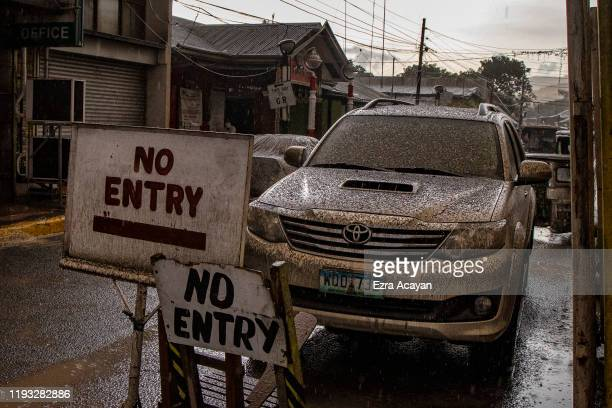 A vehicle covered in ash mixed with rainwater is seen as Taal Volcano erupts on January 12 2020 in Talisay Batangas province Philippines Local...