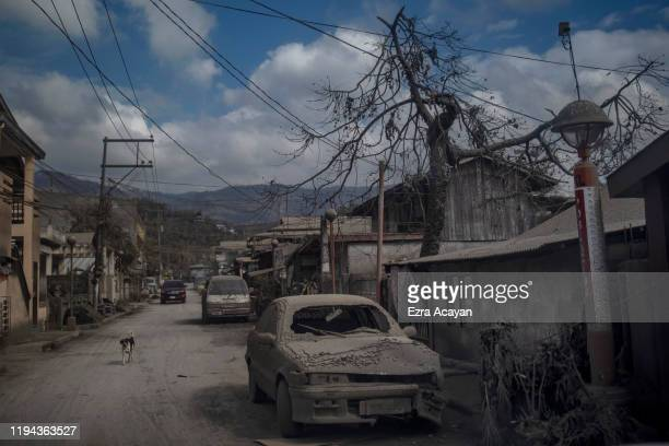 A vehicle covered in volcanic ash from Taal Volcano's eruption is seen on January 18 2020 in Talisay Batangas province Philippines The Philippine...