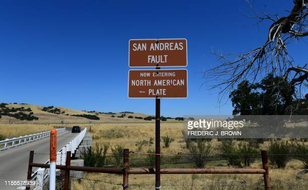 A vehicle crosses a bridge over the San Andreas Fault from the Pacific to the North American tectonic plates near Parkfield California on July 12...