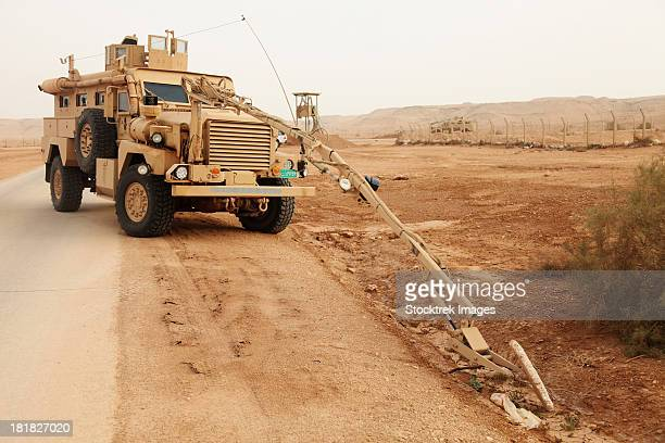 A MRAP vehicle disassembles an improvised explosive device.