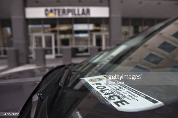 A vehicle displaying a US Department of Commerce Bureau of Industry and Security Office of Export Enforcement Police windshield placard sits parked...