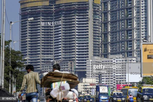 Vehicle drive past the under construction Minerva tower, developed by Lokhandwala Infrastructure Pvt., in the Mahalaxmi area of Mumbai, India, on...