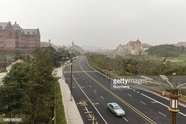 A vehicle drives along a road at the Huawei Technologies Co campus in Dongguan China on Tuesday Jan 15 2019 Ren Zhengfei the billionaire founder...
